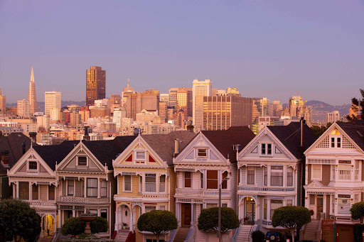 "Alamo-Square-evening-sf - One of the most photographed locations in San Francisco, Alamo Square's famous row of Victorian houses, dubbed the ""painted ladies,"" is a visual treat you'll find at Hayes and Steiner streets."