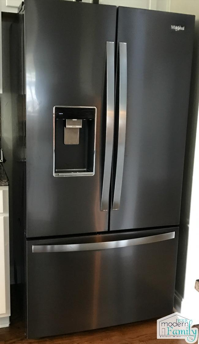 A stainless steel refrigerator in a kitchen.