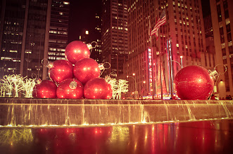 """Photo: """"Holiday decorations in New York City...""""  Happy holidays everyone!!  I eagerly wait for December because I know that Rockefeller Center and surrounding areas of midtown Manhattan will be dolled up in their holiday finest. Tree branches are entirely ensconced with holiday lights, giant ornaments sit stop golden fountains and even street food vendors go out of their way to accessorize their food stands with holiday decorations.  This display close to Rockefeller Center is one of my favorites. It's a New York City holiday decoration extravaganza. It sits across from Radio City Music Hall (home of the Rockettes and Radio City Christmas Spectacular) on 6th Avenue and is absolutely gorgeous at night. Giant red ornament balls sit on a fountain which is surrounded by trees ensconced in holiday lights.      New York Photography: 6th Avenue holiday decorations at night    You can view this post along with information about where to purchase prints of this image at my site here:  http://nythroughthelens.com/post/38726220625/giant-red-ornaments-on-6th-avenue-midtown-holiday  -  Tags: #photography  #happyholidays   #newyorkcity  #newyorkcityphotography  #nyc  #manhattan  #winter  #night  #christmas  #holidaydecorations  #christmas2012  #nycchristmas  #newyorkchristmas  #nycholidaydecorations  #newyorkholidaydecorations  #6thavenue  #ornaments  #xmas  #xmas2012  #nycxmas  #newyorkxmas  #xmasdecorationsnyc"""