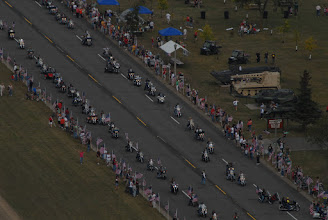 Photo: The Minnesota Patriot Guards flag line rolls down the main road of Camp Ripley.