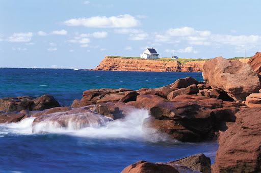 Waves hitting the sandstone rocks at Chepstow on Prince Edward Island, Canada.