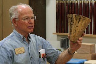 Photo: Phil talks about the spalted maple end grain vessel that he positioned for maximum spalt!