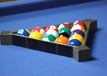 a full black pool triangle on a pool table