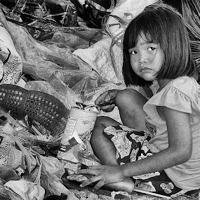 Hunger Pains Young Thai Girl Eating from a Landfill Garbage Tip by James Morris - Black & White Street & Candid ( poor, urban street photography, thailand, homeless, garbage, rubbish, girl, homelessness, landfill,  )