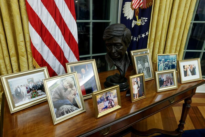 A bust of Mexican American labor leader Cesar Chavez joins family photos behind the Resolute Desk.REUTERS/Jonathan Ernst
