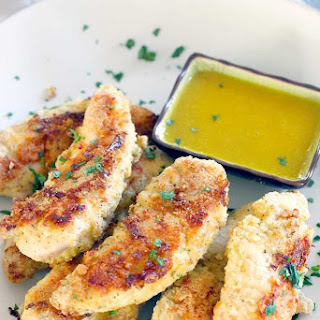 Paleo Oven-Fried Chicken Tenders with Honey Mustard Sauce.