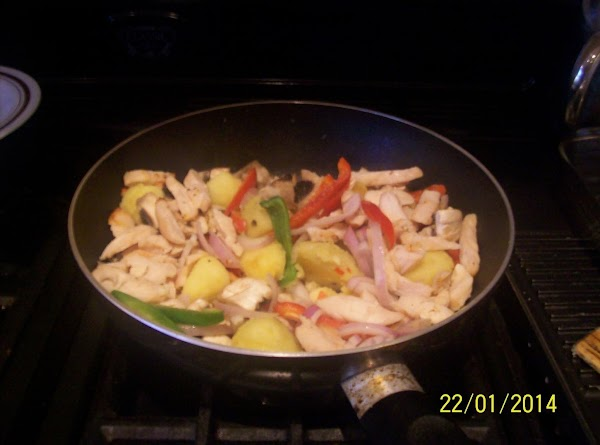 Then add to the potatoes all the prepared vegetables and cooked chicken and cook...