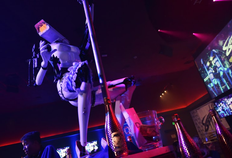 Stripper robots perform at the Sapphire Gentlemen's Club on the sidelines of CES 2018 in Las Vegas on January 8, 2018.