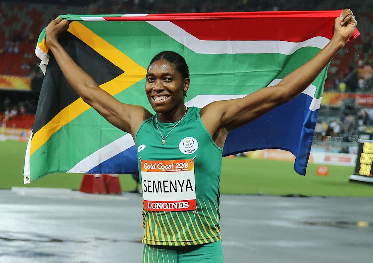 Caster Semenya of South Africa holds up the national flag after winning the women's 1500m final at the Gold Coast 2018 Commonwealth Games in Australia, April 10 2018. Picture: GALLO IMAGES
