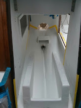 Photo: Four coats of epoxy primer on beds and hull (top of beds have one coat primer)