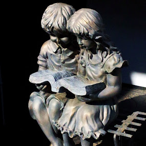 Two Children Reading by Tom Carson - Instagram & Mobile Android ( bronze, sculpture, children )
