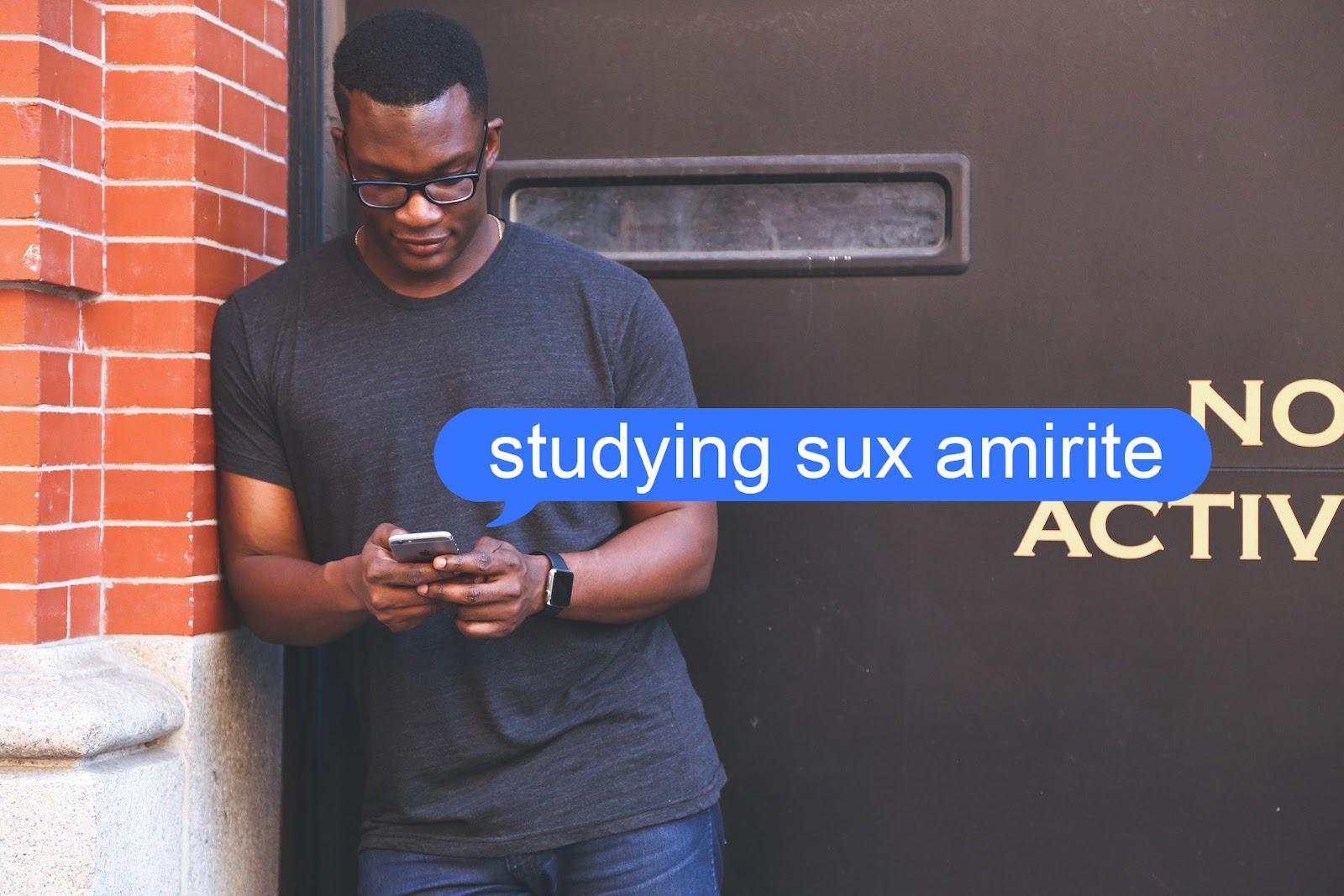 Man texting on a study break