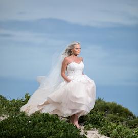 Bride on Beach by Lood Goosen (LWG Photo) - Wedding Bride ( bride, wedding dress, wedding photography, wedding photographer, white dress, walking, wedding day, wedding photographers, brides, wedding, fashion )