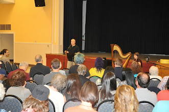 Photo: Michael Dylan Welch introduces harpist Monica Schley.