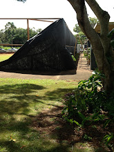 Photo: Putting up the black tarp by A-building