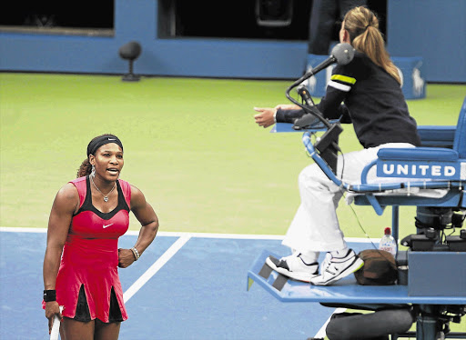 Serena Williams argues with the umpire during her match against Samantha Stosur of Australia in the final at the US Open in New York on Sunday Picture: JESSICA RINALDI/REUTERS