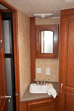 Photo: The bathroom has a small sink, toilet, and shower plus a closet in which to hang clothes.