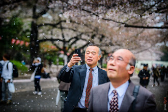 Photo: Like little boys at an amusement park...  These Japanese businessmen take in the beauty of their fair city and the cherry blossom festival.  #blogged