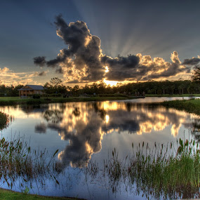 Sunset Over Town Center by Rob Frederick - Landscapes Sunsets & Sunrises ( clouds, water, sunset, reflections, pond, sun )