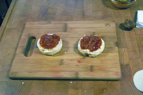 Add about a tablespoon of marinara sauce to the cut surface of both halves.