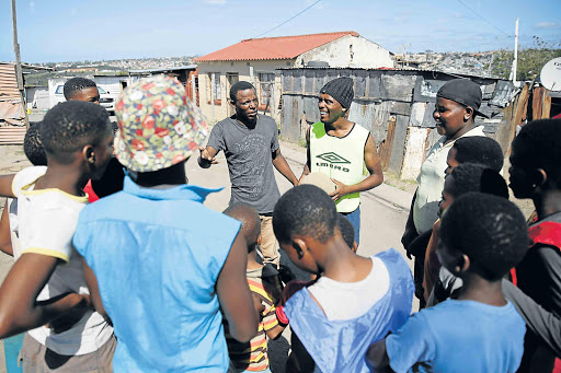 MAKING A DIFFERENCE: Chairman Thembekile Havi and mentor Aphiwe Bili at the centre in Duncan Village where they help to keep young teens off drugs Picture: MARK ANDREWS