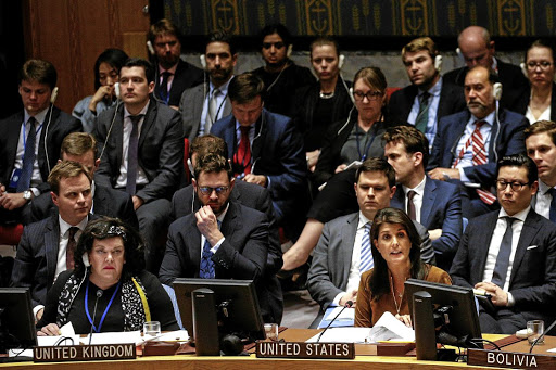 UK ambassador to the UN Karen Pierce, front left, listens as her US counterpart, Nikki Haley, addresses the Security Council meeting on Syria at UN headquarters in New York on April 9 2018. Picture: REUTERS