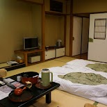 making the beds by the maid/japanese nakai in the $500 Ryokan at Senkei in Yumoto, Hakone in Hakone, Kanagawa, Japan