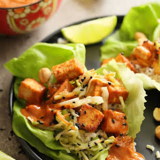 Vegan Korean Tofu Lettuce Wraps with Tahini Gochujang Sauce and Spicy Slaw.