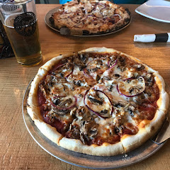 My gf 'The Bricks', a Peroni (beer), and a regular BBQ Chicken pizza in the background, for comparison.