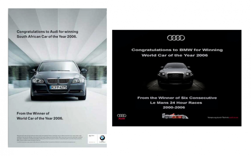 posters of BMW and Audi side by side