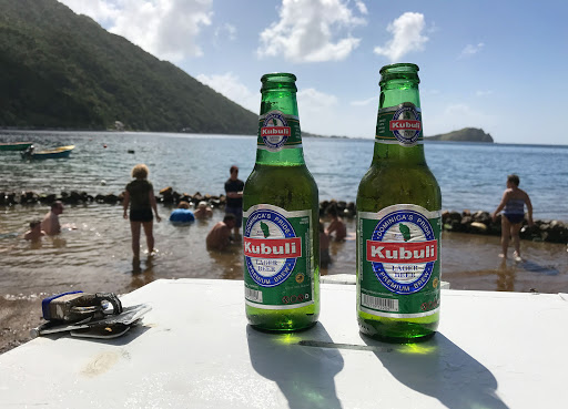 "kubuli.jpg - Kubuli lager beer, ""Dominica's pride,"" at a volcano-heated hot spot on Dominica."