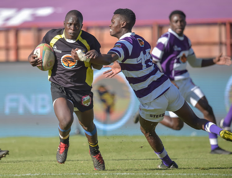 UFS's Lukhanyiso Tosholwana, left, on his way to scoring during the Varsity Shield match against Rhodes at Loftus Versfeld on Tuesday.