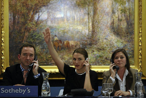 Setting the price: Sotheby's employees accept phone bidding at an auction in Melbourne, Australia. Picture: BLOOMBERG