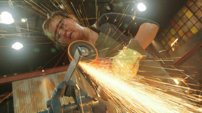 Kim Throwing Sparks on Episode One, Season Two of Forged in Fire