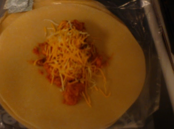 Preheat oven to 375 degrees. Spoon chicken mixture into tortillas, roll and place inside...