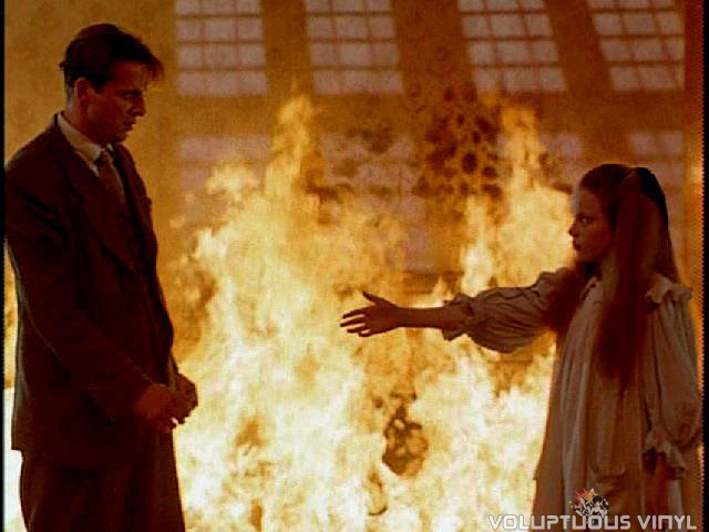 David (Aidan Quinn) sees his dead sister while engulfed in flames in the film Haunted.