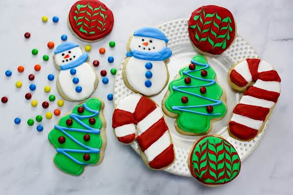 A Plate Of Christmas Vanilla Butter Cutout Cookies.