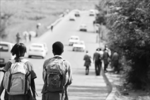 DANGER: Schoolchildren walk on the stretch of road between Protea North and Protea Glen where the four pupils were killed on Monday. Pic: BAFANA MAHLANGU. 10/03/2010. © Sowetan.