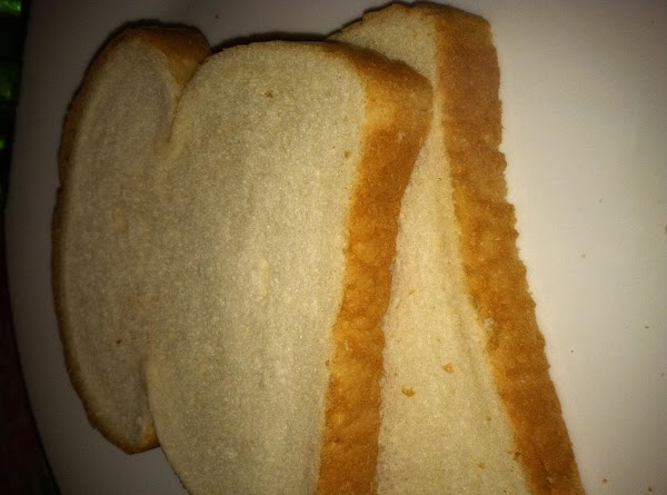 Spread the two slices of bread with the mayonnaise