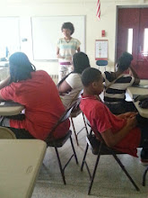 Photo: Our Financial Educator Britney Gaines discussed with the youth the importance of saving and financial literacy