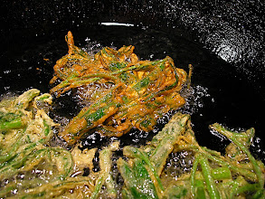 Photo: frying morning glory fritters