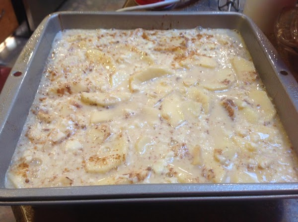 Pour liquid ingredients carefully over the apples, then place in preheated 350 degree oven...