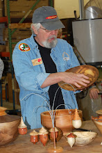 Photo: Ed Karch explains using wipe on poly on his elm platter.