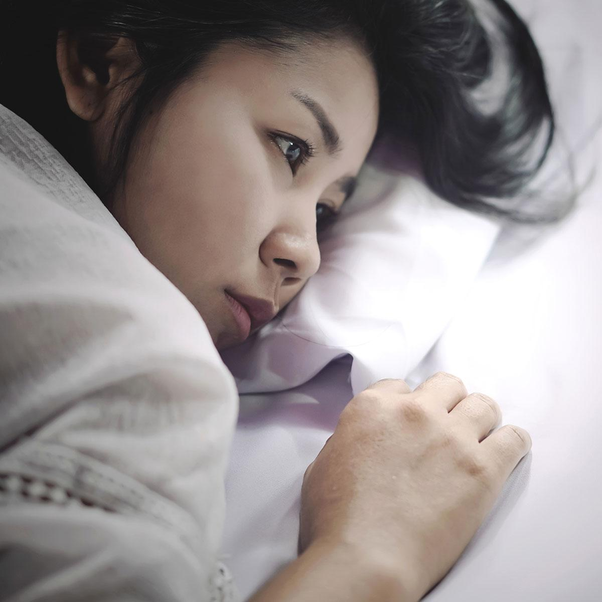 A person lying in bedDescription automatically generated with low confidence