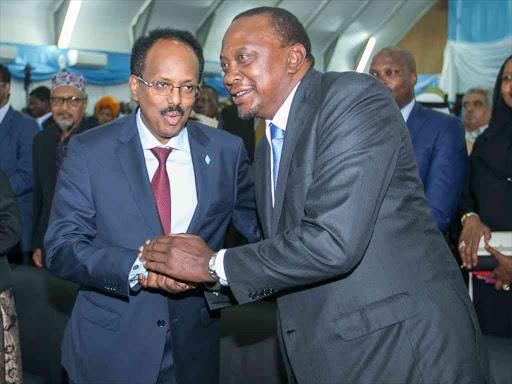 Somalia President Mohamed Abdullahi Farmajo and President Uhuru Kenyatta during Farmaajo's inauguration in Mogadishu, Somalia.