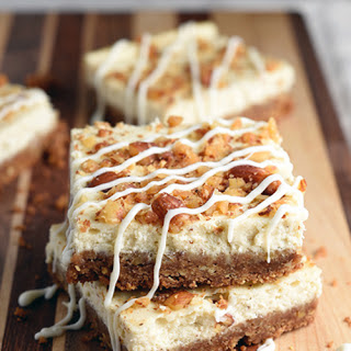 Eggnog Cheesecake Bars with White Chocolate Drizzle