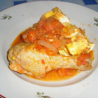 Chicken in Tomato souse With Fried Eggs