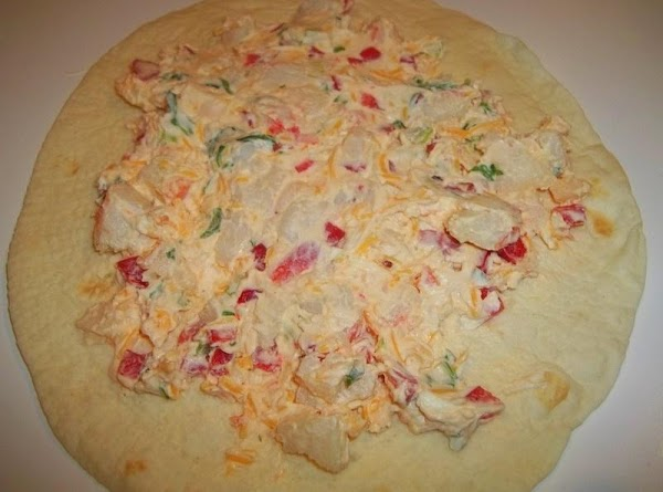 Lay out your tortilla's  Spread about 1/4 cup onto each tortilla.