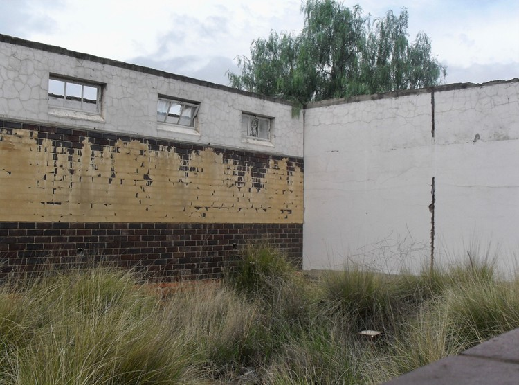 Tall grass is growing in what should have been a finished classroom at Winterberg Primary School in Uitenhage.