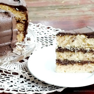 Triple Layer Vanilla Cake with Whipped Dark Chocolate Frosting.